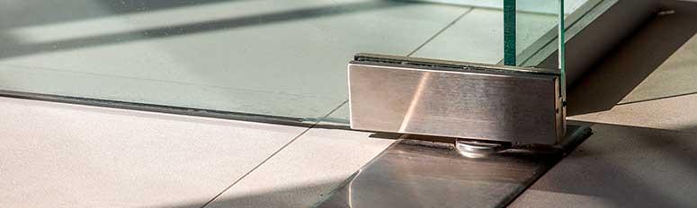 Підлогові пружинні дверні доводчики